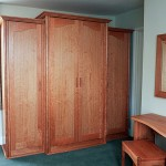 A large free-standing wardrobe in American Cherry
