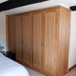 2 built-in side-by-side double oak wardrobes.
