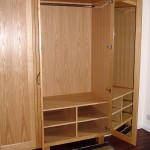 A pair of wardrobes in European Oak similar to the others on this page but without the drawers. Internal view.