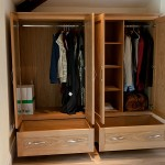 A pair of wardrobes in European Oak. Internal view.