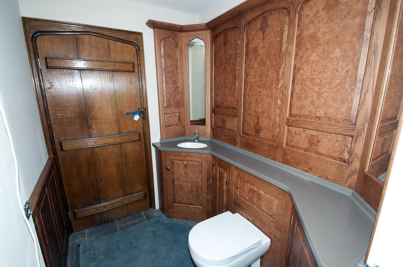 Cloak room in burr oak and Corian