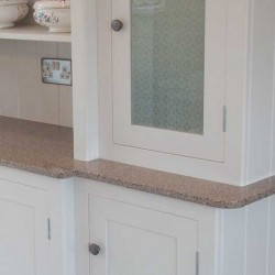 Built-in dresser with a painted finish and Arenastone worktop
