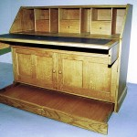 Oak bureau showing the secret drawer concealed in the plinth