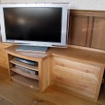 Sideboard in Oak for a TV and other equipment. The design incorporates moulding details found in the room's Oak wall panelling