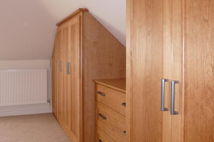 Wardrobes in cherry built in to a loft conversion