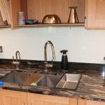 Unusual but highly practical stainless steel draining rack over sink