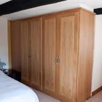 2 built-in side-by-side double oak wardrobes.