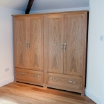A pair of wardrobes in European Oak. Even though the drawers are large, they open easily and smoothly on full-extension runners with a soft-closing action.