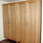A pair of wardrobes in European Oak similar to the others on this page but without the drawers.