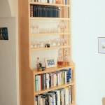 A free-standing bookcase in Maple with a matt lacquered finish