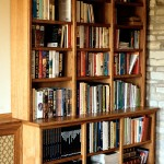One of a pair of built-in bookcases in Oak with a lightly stained finish