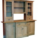 Dresser in solid Oak with wrought Iron handles. The timber selected for the door panels and drawer front has some very fine figure, particularly characteristic of English and European Oak