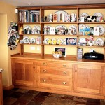 A built-in dresser made as part of an Oak kitchen. The top part is fairly traditional with its stepped and graduated open shelves. The bottom part has some large pan drawers in the centre section