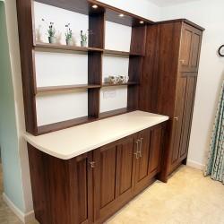 American Black Walnut cabinets with Bone coloured Corian worktops