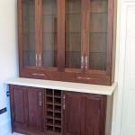 American Black Walnut display cabinets with Bone coloured Corian worktops