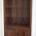 One of a pair of American Black Walnut alcove cabinets