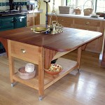 Drop-leaf kitchen work table in Sweet Chestnut with an Iroko top, all finished with linseed oil